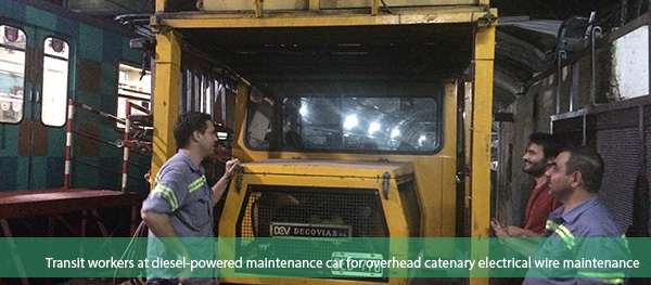 Transit workers at diesel-powered maintenance car for overhead catenary electrical wire maintenance